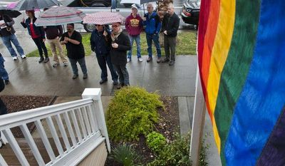 **FILE** Gay-marriage supporters outside the Sacramento Gay and Lesbian Center in Sacramento, Calif., listen during a news conference on the Proposition 8 decision on Feb. 7, 2012. (Associated Press/The Sacramento Bee)