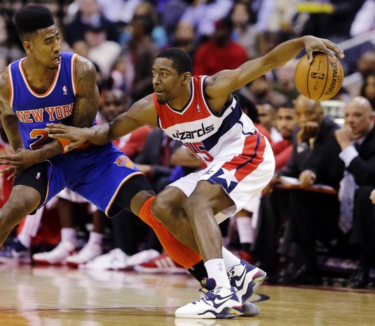 Washington Wizards guard Jordan Crawford (15) works to get past New York Knicks guard Iman Shumpert (21) in the first half of an NBA basketball game, Wednesday, Feb. 6, 2013, in Washington. The Wizards won 106-96. (AP Photo/Alex Brandon)