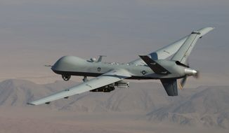 In this undated handout file photo provided by the U.S. Air Force, an MQ-9 Reaper, armed with GBU-12 Paveway II laser guided munitions and AGM-114 Hellfire missiles, is piloted by Col. Lex Turner during a combat mission over southern Afghanistan. (AP Photo/Lt. Col.. Leslie Pratt, US Air Force, File)