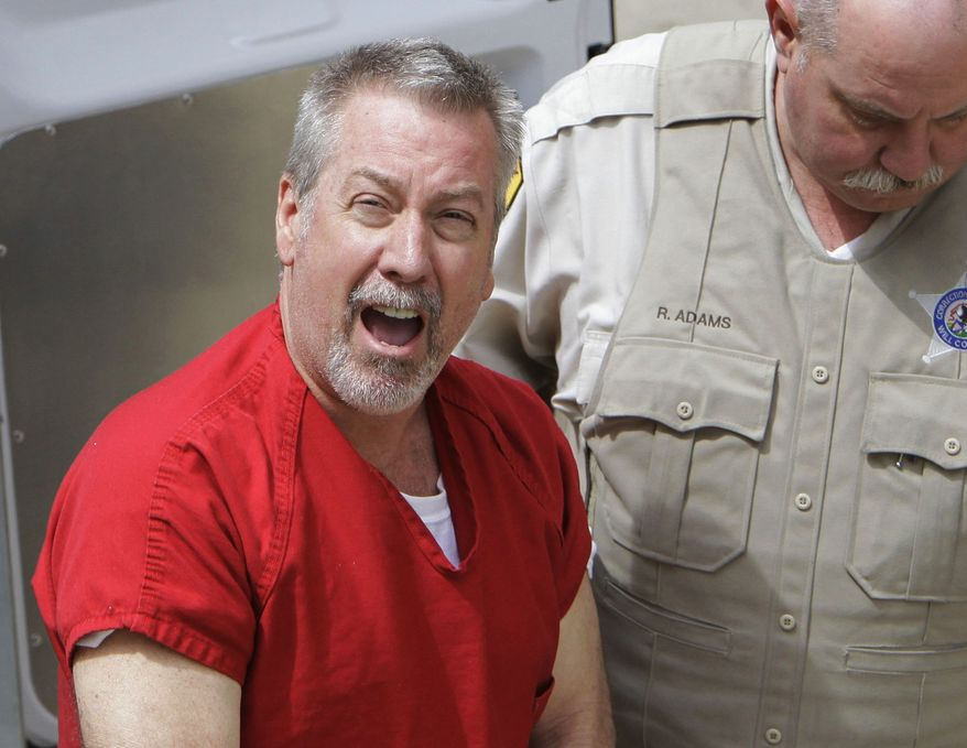 ** FILE ** In this May 8, 2009, file photo, former Bolingbrook, Ill., police sergeant Drew Peterson arrives at the Will County Courthouse in Joliet, Ill., for his arraignment on charges of first-degree murder in the 2004 death of his third wife Kathleen Savio. On Thursday, Feb. 21, 2013, Will County Judge Edward Burmila sentenced Peterson to 38 years in prison for Savio's murder. (AP Photo/M. Spencer Green, File)