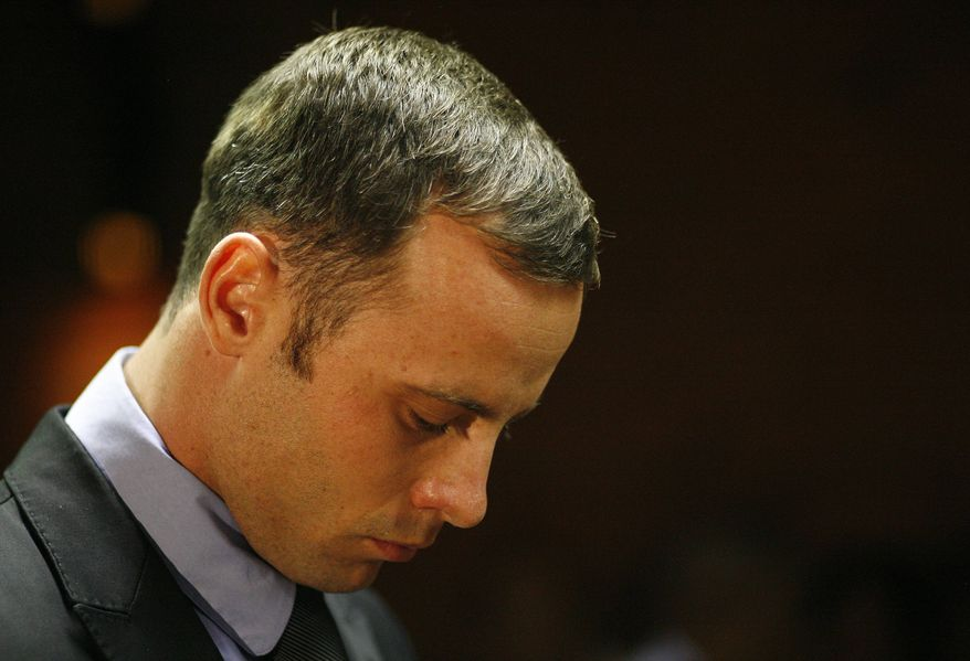 Olympic athlete Oscar Pistorius stands during his bail hearing at the magistrate court in Pretoria, South Africa, Thursday, Feb. 21, 2013. (AP Photo/Themba Hadebe)