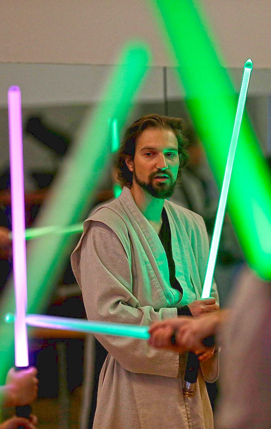 Golden Gate Knights instructor Alain Block teaches during class in San Francisco on Feb. 10, 2013. A group of San Francisco Star Wars fans who want to travel to a galaxy not that far away have created a combat choreography class for Jedis-in-training with their weapon of choice: the light saber. (Associated Press)