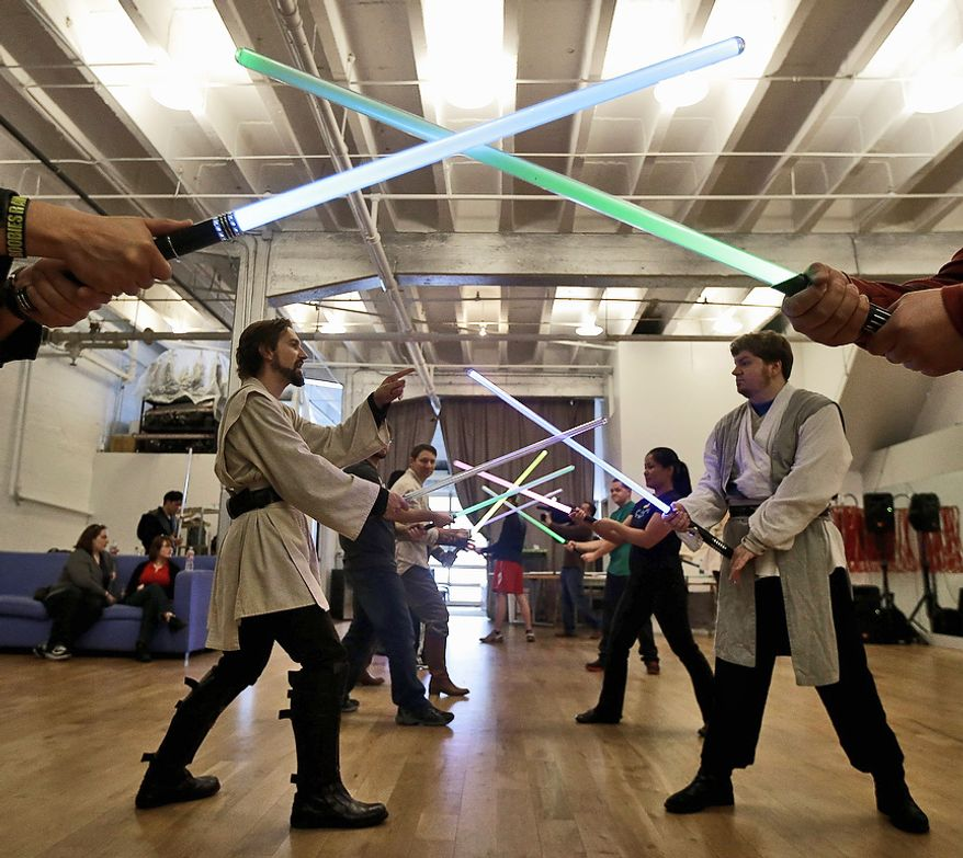 Golden Gate Knights instructors Alain Block (left) and Frank Knight teach saber moves during class in San Francisco on Feb. 10, 2013. A group of San Francisco Star Wars fans who want to travel to a galaxy not that far away have created a combat choreography class for Jedis-in-training with their weapon of choice: the light saber. (Associated Press)