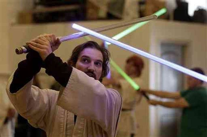 In San Francisco, Golden Gate Knights instructor Alain Block teaches a combat choreography class for Jedis-in-training with their weapon of choice: the light saber. (AP Photo/Jeff Chiu)