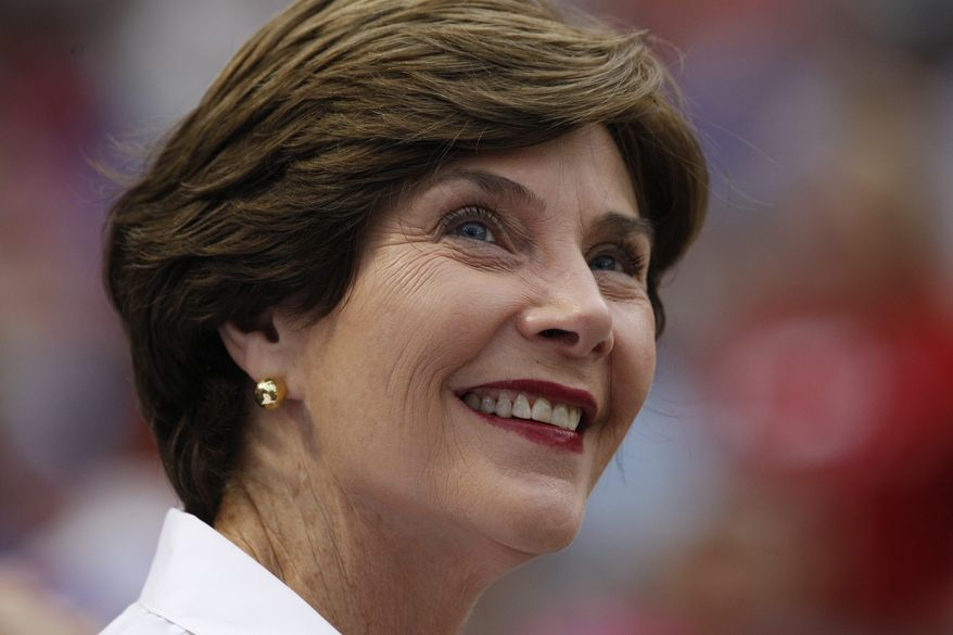** FILE ** In this July 7, 2012, file photo former first lady Laura Bush is seen in Arlington, Texas. Bush spokeswoman Anne MacDonald said Wednesday, Feb. 20, 2013, that the former first lady wants to be removed from a pro-gay marriage group's national advertising campaign featuring prominent people speaking on the topic. (AP Photo/LM Otero, File)