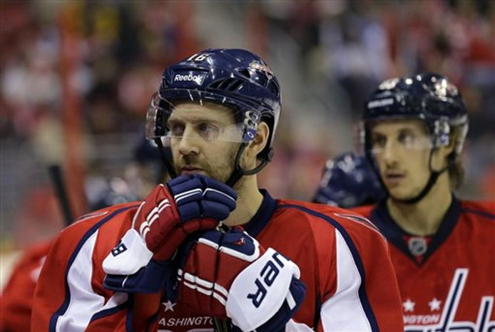 Washington Capitals right wing Eric Fehr (16) pauses on the bench, in the third period of an NHL hockey game against the Toronto Maple Leafs Tuesday, Feb. 5, 2013 in Washington. The Maple Leafs won 3-2. (AP Photo/Alex Brandon)