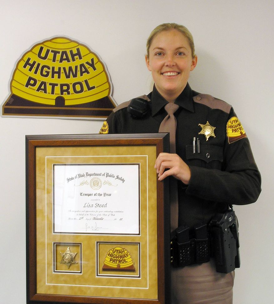 ** FILE ** Utah Highway Patrol Officer Lisa Steed holds her award after being named Trooper of the Year in this undated file photo provided by the Utah Highway Patrol on Nov. 11, 2007. Once a rising star in the ranks of the Utah Highway Patrol, Steed has taken a stunning fall from grace based on allegations that she booked dozens of people for DUIs when they hadn't been drinking at all. (AP Photo/Standard-Examiner, Utah Highway Patrol)