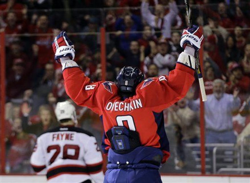 Washington Capitals left wing Alex Ovechkin, from Russia, celebrates after his second goal of the game in the third period of an NHL hockey game against the New Jersey Devils Saturday, Feb. 23 in Washington. The Capitals won 5-1. (Associated Press)