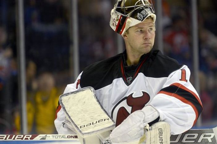 New Jersey Devils' goalie Johan Hedberg reacts after New York Islander's John Tavares scored the first goal of an NHL hockey game in the second period in Uniondale, N.Y., Saturday, Feb. 16, 2013. (AP Photo/Henny Ray Abrams)