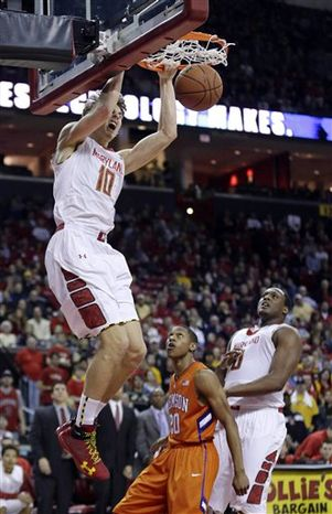 Maryland guard Jake Layman (10) dunks over Clemson guard Jordan Roper, bottom center, and Maryland forward Charles Mitchell in the second half of an NCAA college basketball game in College Park, Md., Saturday, Feb. 23, 2013. Layman contributed 12 points to Maryland's 72-59 win. (AP Photo/Patrick Semansky)