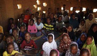 Children attend a class in a madrassa in Gao, northern Mali, February 18.