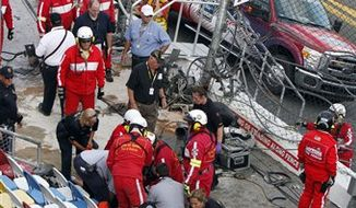 Spectators are injured after a tire and engine off Kyle Larson's car flew into the stands during a crash at the conclusion of the NASCAR Nationwide Series auto race Saturday, Feb. 23, 2013, at Daytona International Speedway in Daytona Beach, Fla. (AP Photo/David Graham)