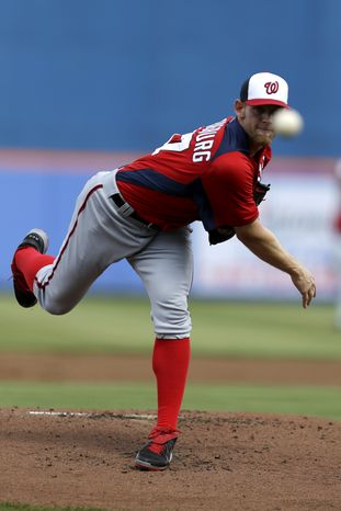 Washington Nationals pitcher Stephen Strasburg warms up during the first inning of an exhibition spring training baseball game against the New York Mets in Port St. Lucie, Fla., Saturday, Feb. 23, 2013. (AP Photo/Julio Cortez)