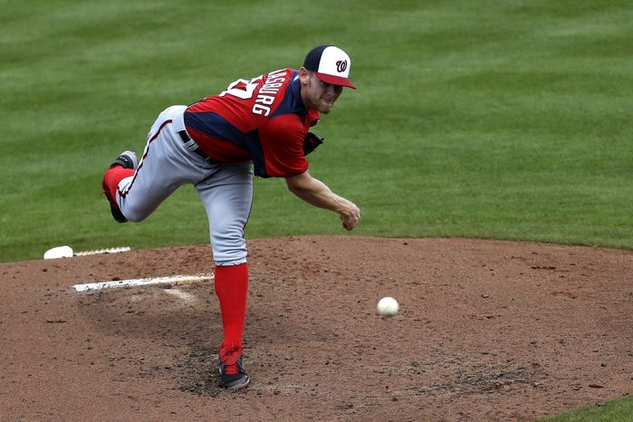 Washington Nationals pitcher Stephen Strasburg throws a pitch against New York Mets second baseman Justin Turner, not pictured, during the second inning of an exhibition spring training baseball game in Port St. Lucie, Fla., Saturday, Feb. 23, 2013, in (AP Photo/Julio Cortez)