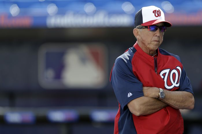 Washington Nationals manager Davey Johnson looks on before an exhibition baseball game against the New York Mets in Port St. Lucie, Fla., Saturday, Feb. 23, 2013, in (AP Photo/Julio Cortez)
