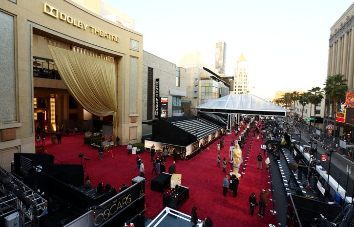 Workers prepare the red carpet for the 85th Academy Awards at the Dolby Theatre in Los Angeles on Saturday, Feb. 23, 2013. The Oscars will be presented on Sunday. (Matt Sayles/Invision/AP)