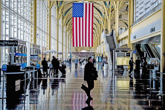 Travelers walk along the main concourse at Ronald Reagan Washington National Airport on Monday, Feb. 25, 2013. (Andrew S. Geraci/The Washington Times)