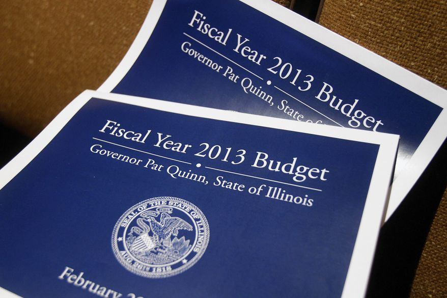 **FILE** Illinois' 2013 Budget books are seen in Springfield, Ill., on Feb. 21, 2012, during a briefing to reporters on the details of Gov. Pat Quinn's upcoming State of the Budget address. (Associated Press)