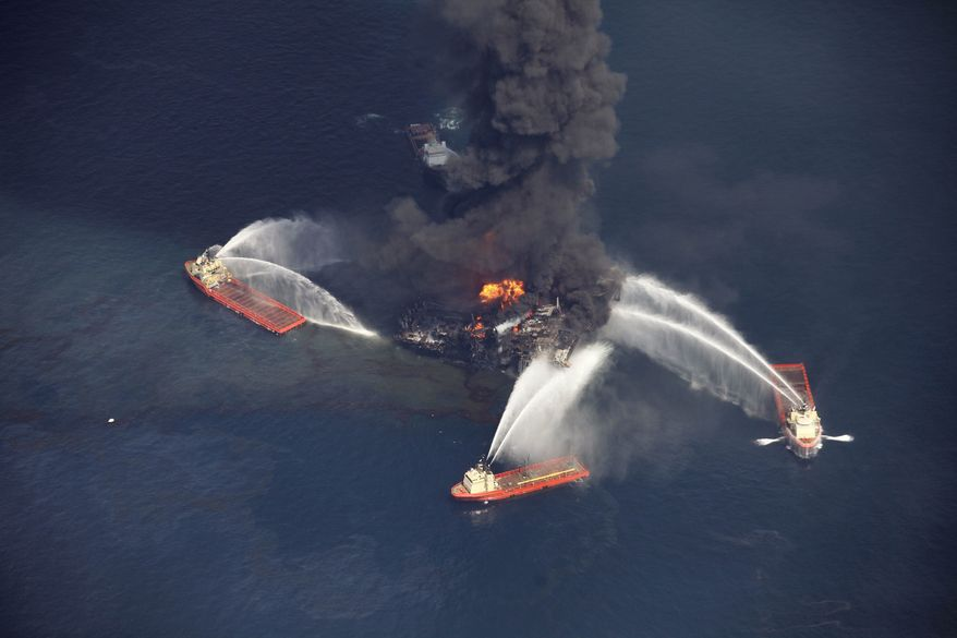 ** FILE ** In this aerial file photo created on Wednesday, April 21, 2010, in the Gulf of Mexico, more than 50 miles southeast of Venice on Louisiana's tip, an oil slick is seen as the Deepwater Horizon oil rig burns. Nearly three years after the deadly rig explosion in the Gulf of Mexico triggered the nation's worst offshore oil spill, a federal judge in New Orleans is set to preside over a high-stakes trial for the raft of litigation spawned by the disaster on Monday Feb. 25, 2013. (AP Photo/Gerald Herbert, file)