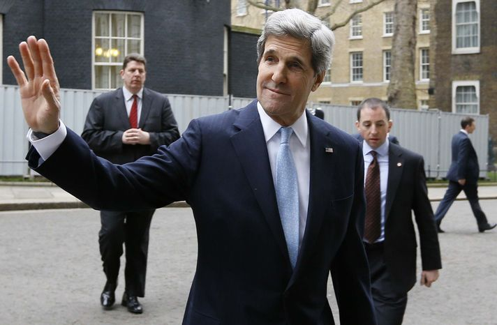 U.S. Secretary of State John Kerry waves to the media as he leaves Downing Street in London, Monday, Feb. 25, 2013. Kerry kicked off his first official overseas trip by meeting with British leaders in London on the first leg of a hectic nine-day dash through Europe and the Middle East. (AP Photo/Kirsty Wigglesworth)
