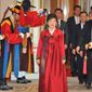 ** FILE ** Park Geun-hye (center), South Korea's new president, arrives for the official dinner at the presidential Blue House in Seoul on Monday, Feb. 25, 2013. Ms. Park took office as the country's first female president earlier in the day. (AP Photo/Kim Jae-hwan, Pool)