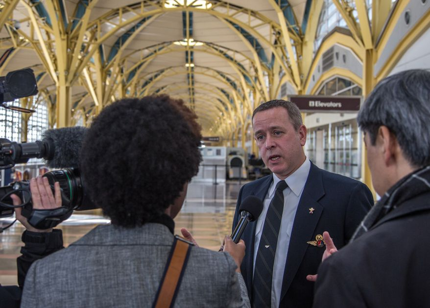 Capt. Sean Cassidy, First Vice President for the Air Line Pilots Association, speaks with members of the press after a briefing concerning sequestration at Reagan National Airport in Washington on Feb. 25, 2013. (Andrew S. Geraci/The Washington Times)