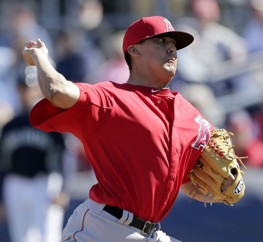 Los Angeles Angels pitcher Chad Cordero throws during an exhibition spring training baseball game against the Seattle Mariners Monday, Feb. 25, 2013, in Peoria, Ariz. (AP Photo/Charlie Riedel)