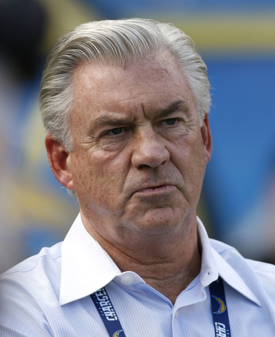 **FILE** San Diego Chargers general manager A.J. Smith looks on from sidelines during an NFL football game between the San Diego Chargers and the Miami Dolphins Sunday, Sept. 27, 2009, in San Diego. (AP Photo/Denis Poroy)