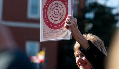 Maryland state Sen. Nancy Jacobs, a Republican, holds up a gun target she shot as she speaks during a pro-gun-rights rally against a proposal by Maryland Gov. Martin O'Malley that would ban so-called assault weapons and require residents to obtain a license before purchasing handguns, at Lawyers Park in front of the Statehouse in Annapolis on Wednesday, Feb. 6, 2013. (Andrew Harnik/The Washington Times)