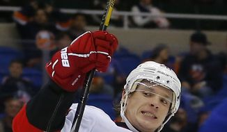 Carolina Hurricanes left wing Alexander Semin (28) celebrates scoring a goal during the third period of an NHL hockey game against the New York Islanders at the Nassau Coliseum in Uniondale, N.Y., Monday, Feb.11, 2013. (AP Photo/Paul J. Bereswill)