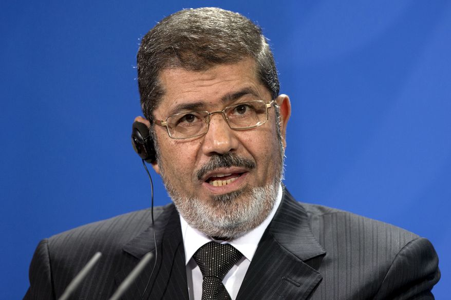 **FILE** Egyptian President Mohammed Morsi addresses the media Jan. 30, 2013, during a joint press conference with German Chancellor Angela Merkel after a meeting at the chancellery in Berlin. (Associated Press)