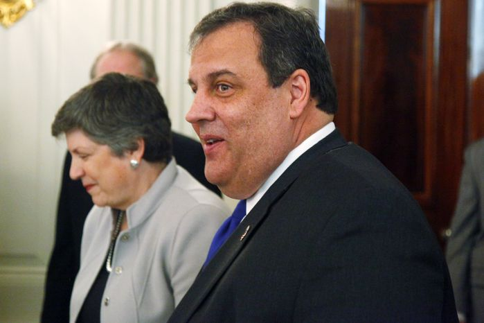 New Jersey Gov. Chris Christie (right) and Homeland Security Secretary Janet Napolitano walk in the State Dining Room of the White House in Washington on Feb. 25, 2013, before President Obama addressed the National Governors Association. (Associated Press)