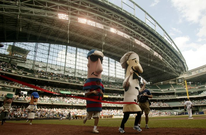 **FILE** Guido, the Italian sausage, right wins in the sausage race at the Pittsburgh Pirates Milwaukee Brewers game in the seventh inning Thursday July 10, 2003 Milwaukee. (AP Photo/Darren Hauck)