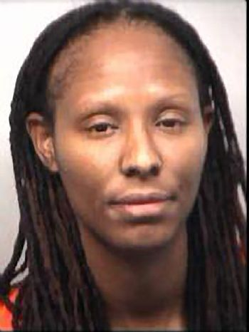 **FILE** This undated photo provided by the Fulton County Sheriff's Office shows Olympic gold medalist and former WNBA star Chamique Holdsclaw. Holdsclaw was in custody Thursday, Nov. 15, 2012, after being accused of shooting into the car of Jennifer Lacy, a player for the Tulsa Shock, after using a bat to break its windows, according to Atlanta police. No one was injured, according to police. (AP Photo/Fulton County Sheriff's Office)