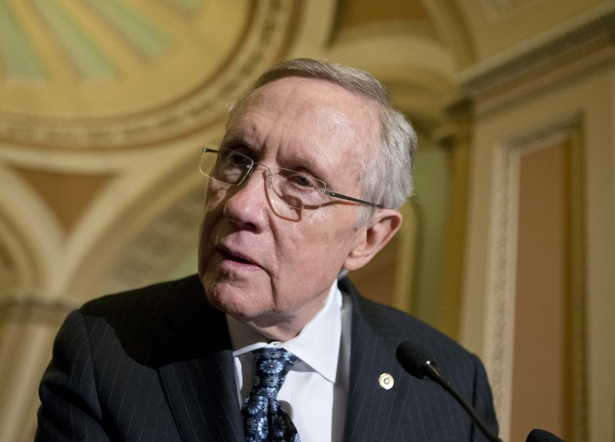 Leaning to hear a reporter's question, Senate Majority Leader Harry Reid, Nevada Democrat, talks Feb. 26, 2013, about the looming automatic spending cuts following a Democratic strategy session on Capitol Hill in Washington. (Associated Press)