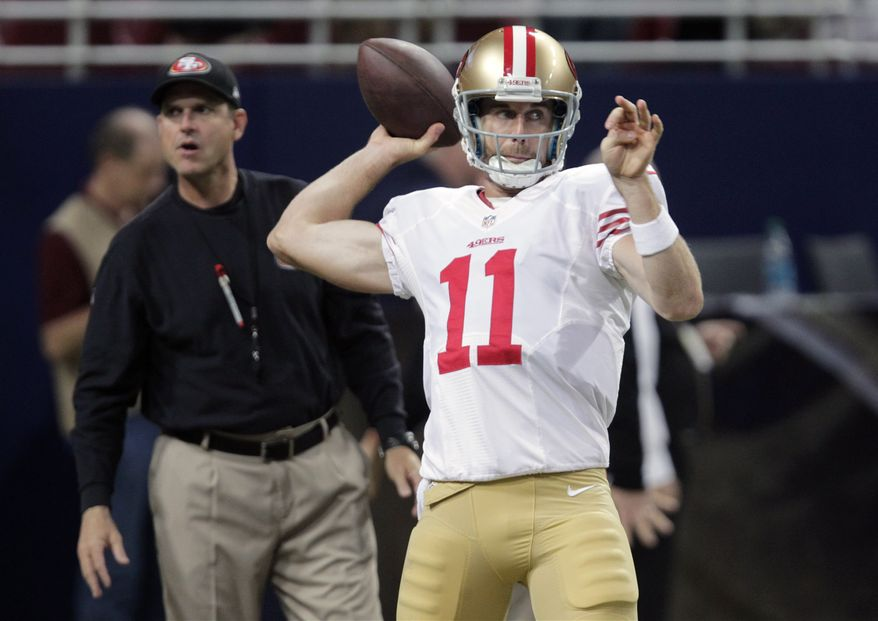 **FILE** In this Dec. 2, 2012 file photo, San Francisco 49ers quarterback Alex Smith warms up as 49ers head coach Jim Harbaugh, left, stands nearby before the start of an NFL football game against the St. Louis Rams in St. Louis. A person with knowledge of the trade tells The Associated Press that the Kansas City Chiefs have agreed to acquire Smith from San Francisco. The person spoke on condition of anonymity on Wednesday, Feb. 27, 2013, because the trade does not become official until March 12, when the NFL's new business year begins. (AP Photo/Tom Gannam, File)