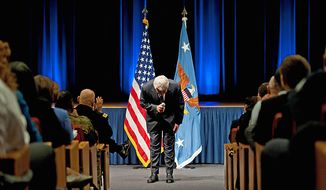 New Secretary of Defense Chuck Hagel gives a bow during his introductory remarks at the Pentagon.