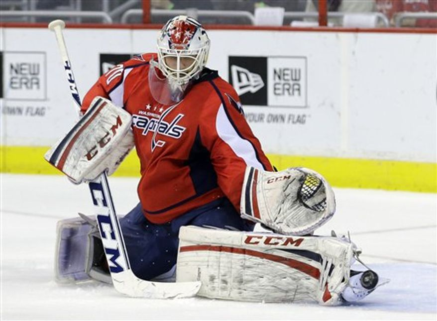 Capitals goaltender Braden Holtby made 33 saves Tuesday against the Hurricanes, including one on a short-handed breakaway by Alexander Semin. (Associated Press)