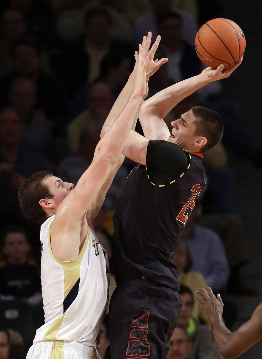 Maryland center Alex Len (25) goes up for a shot as Georgia Tech center Daniel Miller defends in the first half of an NCAA college basketball game on Wednesday, Feb., 27, 2013, in Atlanta. (AP Photo/John Bazemore)