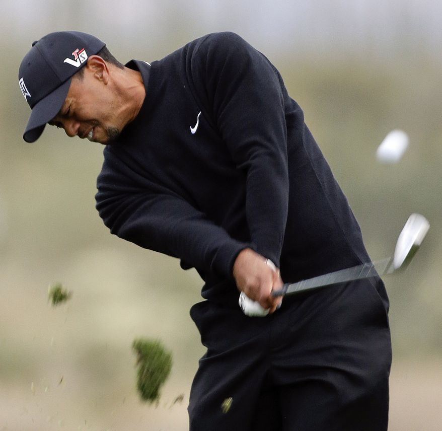 Tiger Woods hits a shot off the 14th fairway in the first round against Charles Howell III during the Match Play Championship golf tournament, Thursday, Feb. 21, 2013, in Marana, Ariz. Howell III won 2 and 1. (AP Photo/Ted S. Warren)