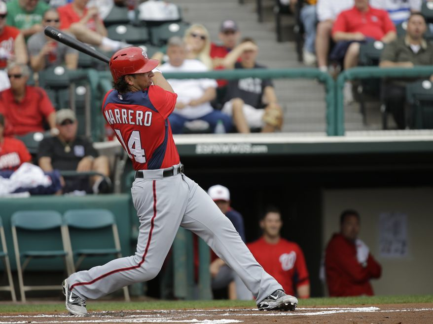 Washington Nationals' Chris Marrero bats against the Atlanta Braves during the first inning of an exhibition spring training baseball game Tuesday, Feb. 26, 2013, in Kissimmee, Fla. (AP Photo/David J. Phillip)
