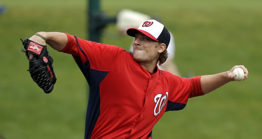 Washington Nationals pitcher Ross Detwiler throws during the first inning of an exhibition spring training baseball game against the Atlanta Braves Tuesday, Feb. 26, 2013, in Kissimmee, Fla. (AP Photo/David J. Phillip)