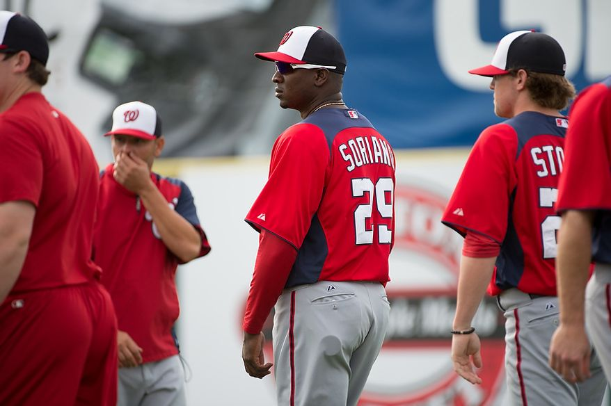 Washington Nationals relief pitcher Rafael Soriano (29) warms up at a morning practice during spring training at Space Coast Stadium, Viera, Fla., Tuesday, February 26, 2013. (Andrew Harnik/The Washington Times)