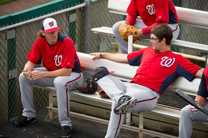 Washington Nationals relief pitchers Tyler Clippard (36), left, and Matt Purke (50), right, talk together at a morning practice during spring training at Space Coast Stadium, Viera, Fla., Tuesday, February 26, 2013. (Andrew Harnik/The Washington Times)