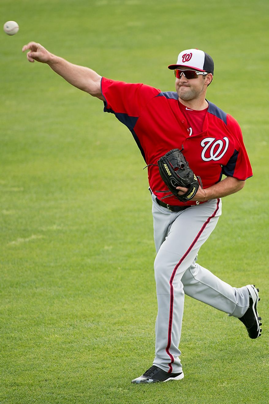 Washington Nationals starting pitcher Nathan Karns (57) warms up at a morning practice during spring training at Space Coast Stadium, Viera, Fla., Tuesday, February 26, 2013. (Andrew Harnik/The Washington Times)