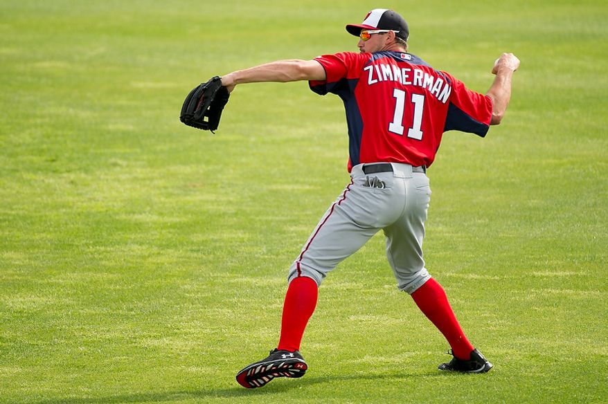 Washington Nationals third baseman Ryan Zimmerman (11) warms up at a morning practice during spring training at Space Coast Stadium, Viera, Fla., Tuesday, February 26, 2013. (Andrew Harnik/The Washington Times)