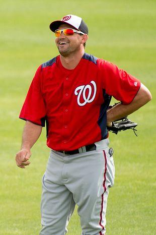 Washington Nationals third baseman Ryan Zimmerman (11) laughs at a morning practice during spring training at Space Coast Stadium, Viera, Fla., Tuesday, February 26, 2013. (Andrew Harnik/The Washington Times)