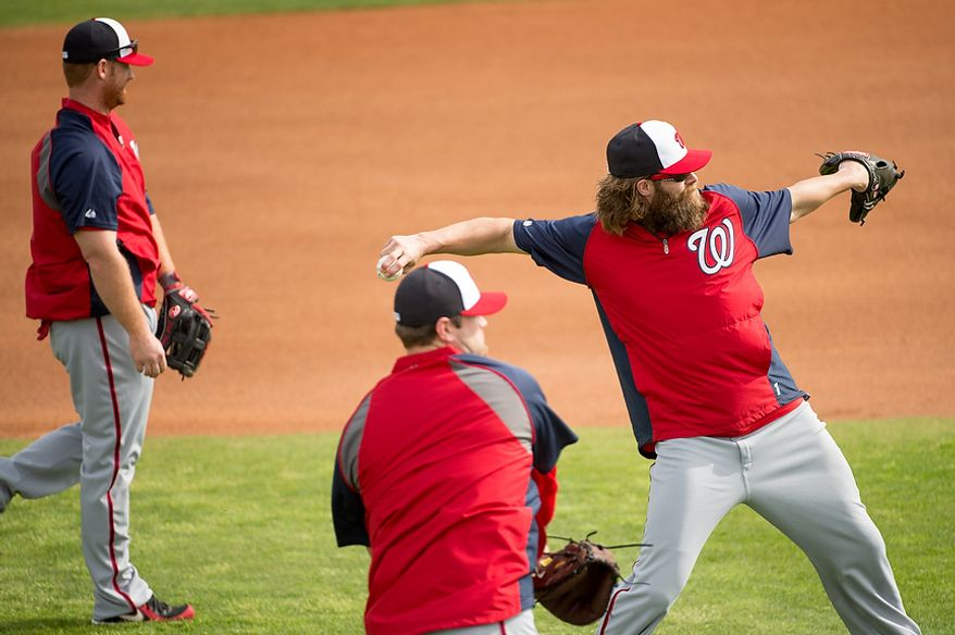 Washington Nationals right fielder Jayson Werth (28), right, warms up at a morning practice during spring training at Space Coast Stadium, Viera, Fla., Tuesday, February 26, 2013. (Andrew Harnik/The Washington Times)