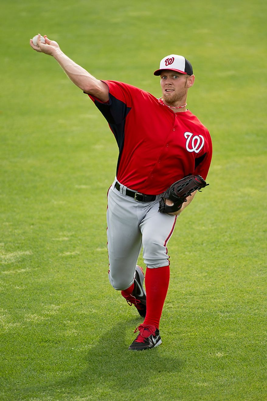 Washington Nationals starting pitcher Stephen Strasburg (37) warms up at a morning practice during spring training at Space Coast Stadium, Viera, Fla., Tuesday, February 26, 2013. (Andrew Harnik/The Washington Times)