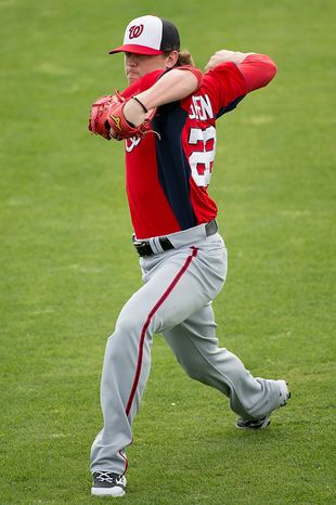 Washington Nationals relief pitcher Drew Storen (22) warms up at a morning practice during spring training at Space Coast Stadium, Viera, Fla., Tuesday, February 26, 2013. (Andrew Harnik/The Washington Times)